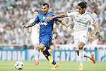 Real Madrid's Raphael Varane (r) and Juventus' Carlos Tevez during Champions League 2014/2015 Semi-finals 2nd leg match.May 13,2015. (ALTERPHOTOS/Acero)