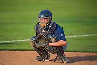 Milan Post (12) of the Helena Brewers warms up the starting pitcher in the bullpen before the game against the Ogden Raptors in Pioneer League action at Lindquist Field on August 19, 2015 in Ogden, Utah.  Ogden defeated Helena 4-2.  (Stephen Smith/Four Seam Images)