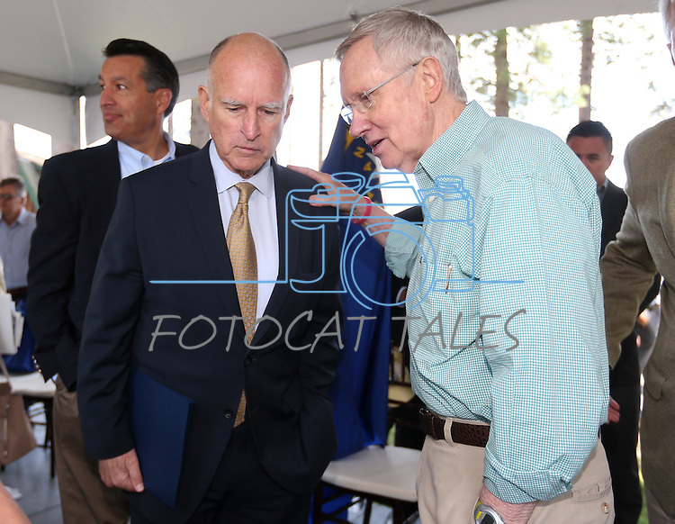 Senate Majority Leader Harry Reid talks with California Gov. Jerry Brown following the 18th annual Lake Tahoe Summit at the Valhalla Estate in South Lake Tahoe, Ca., on Tuesday, Aug. 19, 2014. The event, which attracts government officials, scientists and educational and environmental agencies from California and Nevada, helps focus on environmental issues key to the preservation of the Lake Tahoe basin. (Las Vegas Review-Journal/Cathleen Allison)