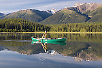 Andy Dappen paddles Old Town canoe on Mayfield Lakes in the northern Rockies of British Columbia.  Muskwa-Kechika Management Area.