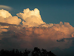 Cumulous thunderhead clouds before storm at sunset