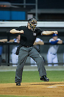 Umpire Grant Hinson calls a batter out on strikes during the Appalachian League game between the Bluefield Blue Jays and the Burlington Royals at Burlington Athletic Stadium on June 27, 2016 in Burlington, North Carolina.  The Royals defeated the Blue Jays 9-4.  (Brian Westerholt/Four Seam Images)