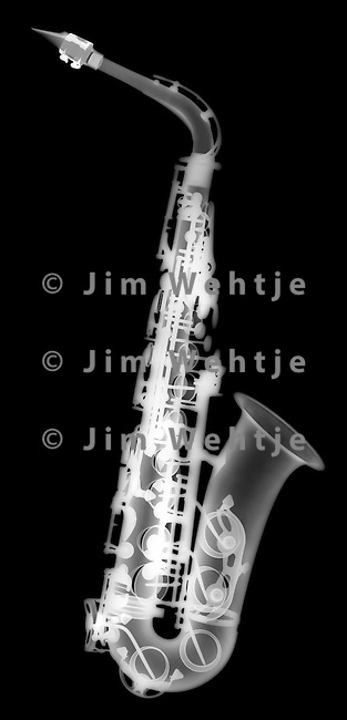X-ray image of an alto saxophone (white on black) by Jim Wehtje, specialist in x-ray art and design images.