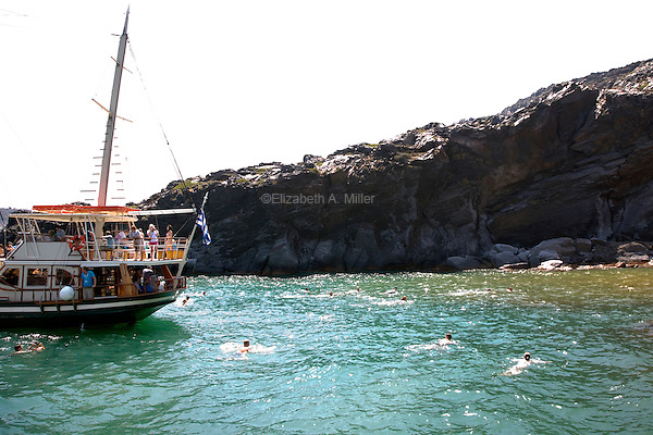 A tour boat at the Hot Springs at the volcano Palea Kameni in Santorini, Greece on July 5, 2013.