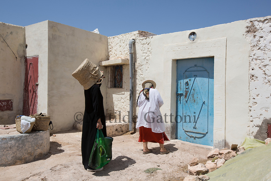Morocco - Tidzi - Nina Amchine (right), president of the Ajddigue cooperative and Hafida El Hantati, producation manager at the cooperative head back home for lunch after a morning spent out in the fields.