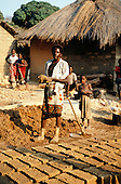 Kalepo, Tanzania. Making adobe bricks for building houses.