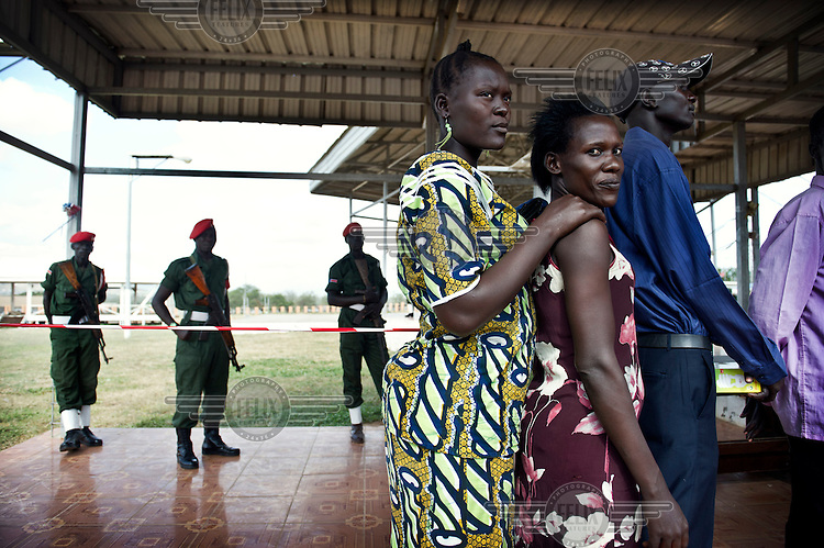 People queue up at a registration centre where residents of the capital Juba can register for the South Sudan independence referendum scheduled for January 2011.