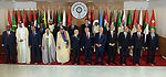 Palestinian President Mahmoud Abbas poses for a group photograph with other Arab leaders during the 30th Arab League summit in the Tunisian capital Tunis on March 31, 2019. Photo by Thaer Ganaim