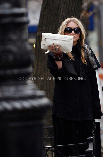 WWW.ACEPIXS.COM . . . . .  ....EXCLUSIVE - ALL ROUNDER....April 4 2010, New York City....Actress Mary-Kate Olsen gets shy as she leaves a house in the West Village on April 4 2010 in New York City....Please byline: NANCY RIVERA- ACEPIXS.COM.... *** ***..Ace Pictures, Inc:  ..Tel: 646 769 0430..e-mail: info@acepixs.com..web: http://www.acepixs.com