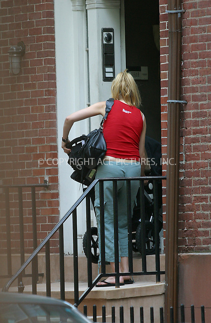 Gwyneth Paltrow returns back home after taking a stroll with her baby Apple.Gwynie's left shoulder is bearing signs of cupping treatment. New York, July 10, 2004. Please byline: BRIAN FLANNERY/ACEPIXS.COM   ..  *** ***..Ace Pictures, Inc:  ..contact: Alecsey Boldeskul (646) 267-6913 ..Philip Vaughan (646) 769-0430..e-mail: info@acepixs.com