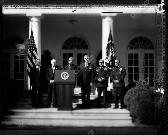 "US President George W. Bush during his ""War on Terror"" statement, surrounded from left to right by Secretary of Defense Donald Rumsfeld, Vice President Dick Cheney, Chairman of the Joint Chiefs of Staff General Richard Myers, Army Generals John Abizaid and George Casey in the Rose Garden at the White House. Washington DC, USA, September 28, 2005"