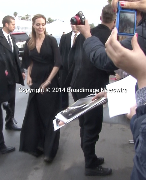 Pictured: Brad Pitt and Angelina Jolie<br /> Mandatory Credit &copy; Fernando Allende/Adriano Camolese/Broadimage<br /> Angelina Jolie gives spanks Brad's Pitt butt as they sign autographs in Santa Monica<br /> <br /> 3/1/14, Santa Monica, California, United States of America<br /> Reference: 030114_FALA_BDG_054<br /> <br /> Broadimage Newswire<br /> Los Angeles 1+  (310) 301-1027<br /> New York      1+  (646) 827-9134<br /> sales@broadimage.com<br /> http://www.broadimage.com