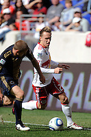 Brian Nielsen (21) of the New York Red Bulls is marked by Jordan Harvey (2) of the Philadelphia Union. The New York Red Bulls defeated the Philadelphia Union 2-1 during a Major League Soccer (MLS) match at Red Bull Arena in Harrison, NJ, on April 24, 2010.