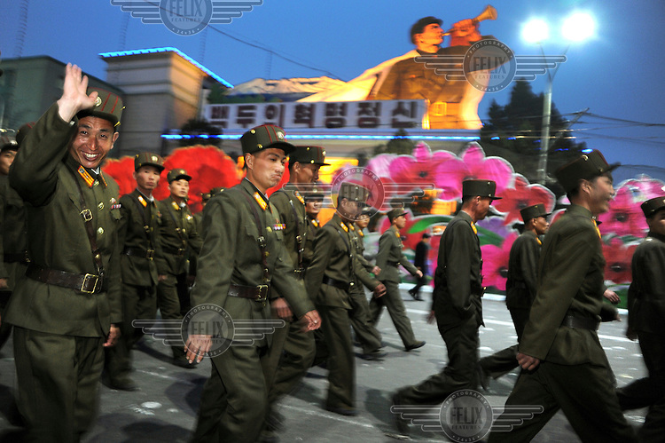 A crowd of soldiers disperses after two new statues of Kim Il-sung and Kim Jong-il, on Mansu Hill, are unveiled by of Kim Jong-un, the new leader of PRNK.