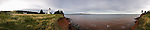 Panorama of lighthouse and coast, Prince Edward Island, Canada.