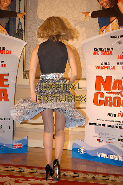 NANCY BRILLI.Photocall for the film di Neri Parenti 'Natale in crociera'.December 13th, 2007.full length black top grey gray silver skirt pattern spinning twirling back behind rear .CAP/CAV.©Luca Cavallari/Capital Pictures.