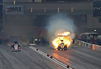 Apr. 6, 2013; Las Vegas, NV, USA: NHRA top fuel dragster driver Terry McMillen (right) explodes an engine alongside Clay Millican during qualifying for the Summitracing.com Nationals at the Strip at Las Vegas Motor Speedway. Mandatory Credit: Mark J. Rebilas-