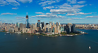 Lower Manhattan view from helicopter: Battery park, financial district skyscrapers, south port and Hudson river