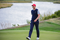 Daniel Berger (USA) heads to congratulate Justin Thomas (USA) for sinking his long birdie putt on 14 during round 3 Four-Ball of the 2017 President's Cup, Liberty National Golf Club, Jersey City, New Jersey, USA. 9/30/2017.<br /> Picture: Golffile | Ken Murray<br /> <br /> All photo usage must carry mandatory copyright credit (&copy; Golffile | Ken Murray)