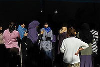Women in line waiting to cast their vote in the first democraticaly held elections in Tunis