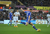 SWANSEA, WALES - JANUARY 17:   of  during the Barclays Premier League match between Swansea City and Chelsea at Liberty Stadium on January 17, 2015 in Swansea, Wales. <br /> Chelsea's Branislav Ivanovic clearing the ball