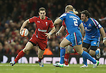 Wales wing George North takes on Italian pair Leonardo Ghiraldini and Mauro Bergamasco.<br /> RBS 6 Nations 2014<br /> Wales v Italy<br /> Millennium Stadium<br /> 01.02.14<br /> <br /> &copy;Steve Pope-SPORTINGWALES