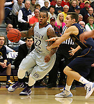 SIOUX FALLS, SD - JANUARY 2:  Charles Ward #22 from the University of Sioux Falls looks to get a step past Steven Schaefer #24 from Augustana in the first half of their game Friday night at the Stewart Center. (Photo by Dave Eggen/Inertia)