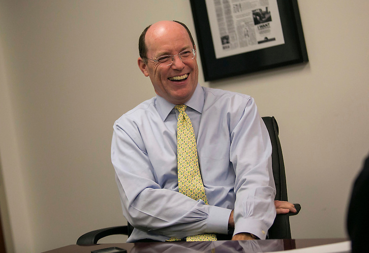 UNITED STATES - August 11: Dennis Kelleher, CEO of Better Markets, laughs during an interview at the offices of Better Markets on K Street NW in Washington D.C. on Tuesday, August 11, 2015. (Photo By Al Drago/CQ Roll Call)