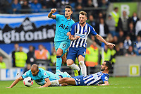 Martín Montoya of Brighton and Hove Albion tackles Lucas of Tottenham Hotspur during Brighton & Hove Albion vs Tottenham Hotspur, Premier League Football at the American Express Community Stadium on 5th October 2019