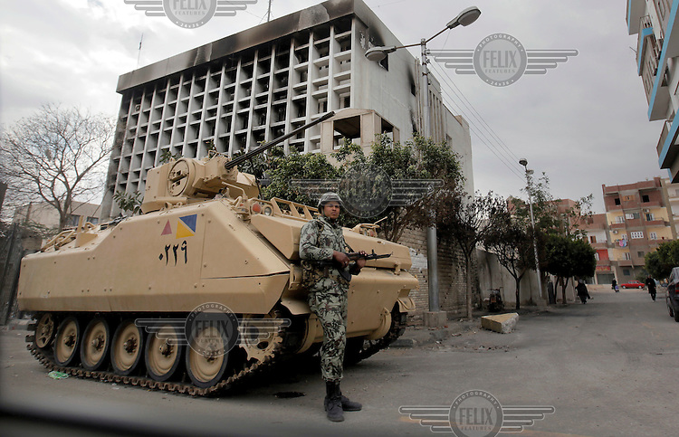 An army tank outside a burned out building in Ismalia, following the revolution that saw president Hosni Mubarak ousted from office.