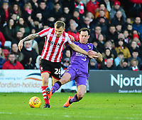 Lincoln City's Harry Anderson battles with Port Vale's Antony Kay<br /> <br /> Photographer Andrew Vaughan/CameraSport<br /> <br /> The EFL Sky Bet League Two - Lincoln City v Port Vale - Tuesday 1st January 2019 - Sincil Bank - Lincoln<br /> <br /> World Copyright &copy; 2019 CameraSport. All rights reserved. 43 Linden Ave. Countesthorpe. Leicester. England. LE8 5PG - Tel: +44 (0) 116 277 4147 - admin@camerasport.com - www.camerasport.com