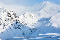 Truck drives the James Dalton Highway through Atigun Pass in Alaska's Arctic.