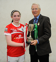 20th September 2014; <br /> GAA Handball President Willie Roche presents the cup to Catriona Casey of Cork<br /> M Donnelly All-Ireland Ladies 60x30 Handball Singes Final<br /> Catriona Casey (Cork) v Martina McMahon (Limerick) . <br /> Abbeylara, Co Longford<br /> Picture credit: Tommy Grealy/actionshots.ie