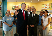 United States President George W.  Bush, meets with Iranian-born businessmen Abolhossein Ejtemai and Ali Assayesh and some of their foreign-born employees at a Dunkin Donuts / Baskin Robbins store in Alexandria, Virginia on July 5, 2006.   The President was in Alexandria to promote his immigration reform plan.<br /> Credit: Ken Cedeno - Pool via CNP