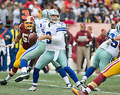 Dallas Cowboys quarterback Tony Romo (9) looks to pass in the second quarter against the Washington Redskins at FedEx Field in Landover, Maryland on Sunday, December 28, 2014.  <br /> Credit: Ron Sachs / CNP