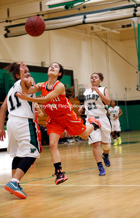 Waterbury, CT- 28 December 2015-122815CM06- Terryville's McKenzie Huria drives to the hoop as Wilby's Jerica Fabian is called for the foul during their non-league basketball matchup in Waterbury on Monday.   Christopher Massa Republican-American