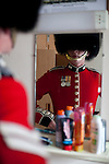 Mcc0023074 . Daily Telegraph..L Cpl Steven Scott checks himself in the mirrorat Wellington Barracks   before going out on the parade ground...The Grenadier Guards preparing for Trooping the Colour in celebration of the Queen's Birthday on June 12 ..The Grenadier Guards only recently finished a six month tour of Helmand , Afghanistan on March 31...London 19 June 2010......Not AP.Not Reuters.Not PA.Not Getty.Not AFP.