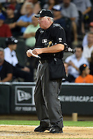 Umpire Time Welke during a game between the Toronto Blue Jays and Chicago White Sox on August 15, 2014 at U.S. Cellular Field in Chicago, Illinois.  Chicago defeated Toronto 11-5.  (Mike Janes/Four Seam Images)