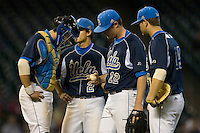 Starting pitcher Gerrit Cole #12 of the UCLA Bruins checks out a blister forming on his finger as his teammates look on at the 2009 Houston College Classic at Minute Maid Park February 28, 2009 in Houston, TX.  The Baylor Bears defeated the Bruins 5-1. (Photo by Brian Westerholt / Four Seam Images)