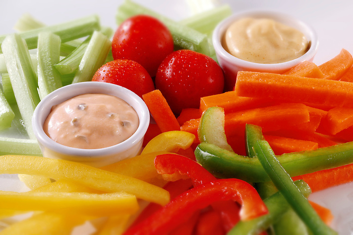 Salad cruite with trips of carrotm cucumber, pepper and tomatoes with dips. Food photos.