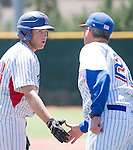 Reno's Duncan Wilmot gets a handshake from coach Savage, right, in the NIAA Division I Northern Region Baseball Championship between the Galena Grizzlies and the Reno Huskies played on Saturday, May 14, 2016 at Peccole Park in Reno, Nevada.