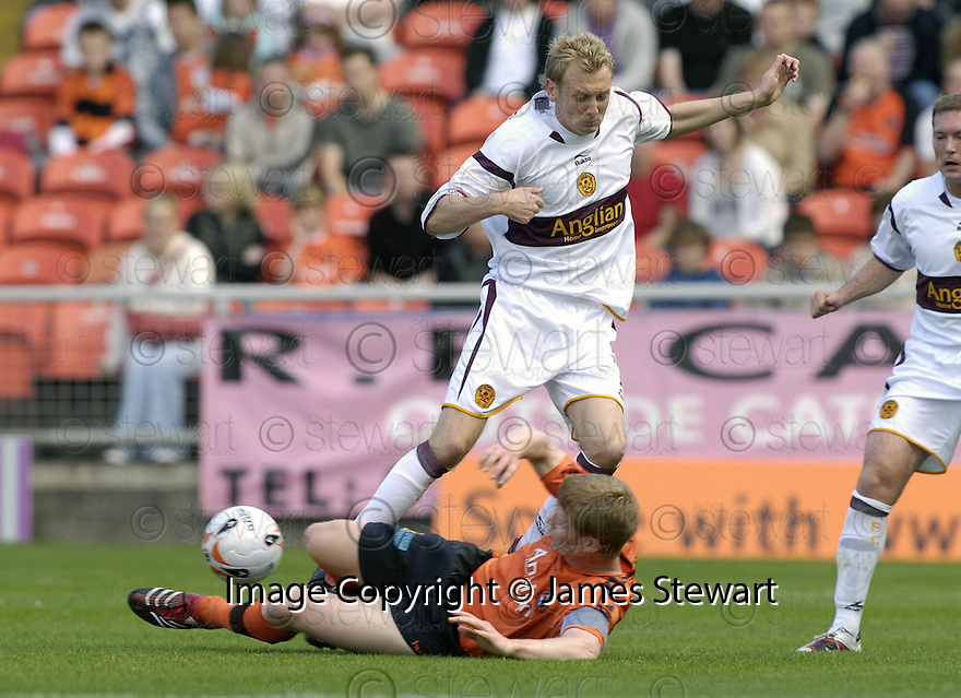 06/10/2007       Copyright Pic: James Stewart.File Name : sct_jspa03_dundee_utd_v_motherwell.BARRY ROBSON TACKLES MOTHERWELL'S STEPHEN HUGHES.James Stewart Photo Agency 19 Carronlea Drive, Falkirk. FK2 8DN      Vat Reg No. 607 6932 25.Office     : +44 (0)1324 570906     .Mobile   : +44 (0)7721 416997.Fax         : +44 (0)1324 570906.E-mail  :  jim@jspa.co.uk.If you require further information then contact Jim Stewart on any of the numbers above........