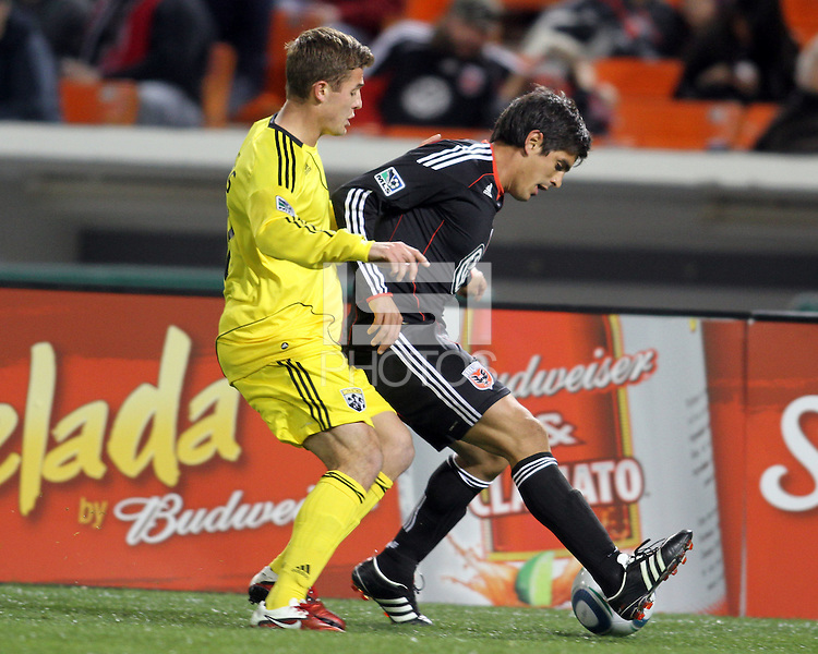 Rodrigo Brasesco#3 of D.C. United keeps the ball away from Robbie Rogers#18  of the Columbus Crew during the opening match of the 2011 season at RFK Stadium, in Washington D.C. on March 19 2011.D.C. United won 3-1.