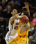 Northern Iowa's Jeremy Morgan, left, pressures Wyoming's Josh Adams 14) during the 2015 NCAA Division I Men's Basketball Championship's  March 20, 2015 at the Key Arena in Seattle, Washington.    Northern Iowa beat Wyoming 71 to 54.   ©2015.  Jim Bryant Photo. All Rights Reserved.