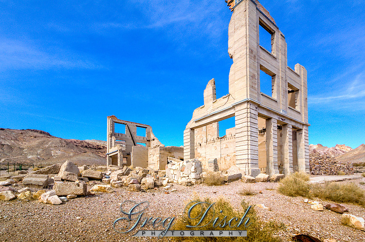 John S Cook and Company Bank Building remains in the Ghost Town of  Rhyolite Nevada.  The 3 story building was the tallest building in town and was completed in 1907.<br /> <br /> Rhyolite is a ghost town in Nye County, in the U.S. state of Nevada. It is located in the Bullfrog Hills, about 120 miles (190 km) northwest of Las Vegas, near the eastern edge of Death Valley.