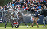 The celebrations begin as Matthew Fitzpatrick (ENG) is sprayed with champagne by his ISM management staff after winning the Final Round of the British Masters 2015 supported by SkySports played on the Marquess Course at Woburn Golf Club, Little Brickhill, Milton Keynes, England.  11/10/2015. Picture: Golffile | David Lloyd<br /> <br /> All photos usage must carry mandatory copyright credit (&copy; Golffile | David Lloyd)