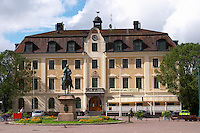 The stadshotell, the town hotel with the equestrian statue on the main square. Eksjo town. Smaland region. Sweden, Europe.