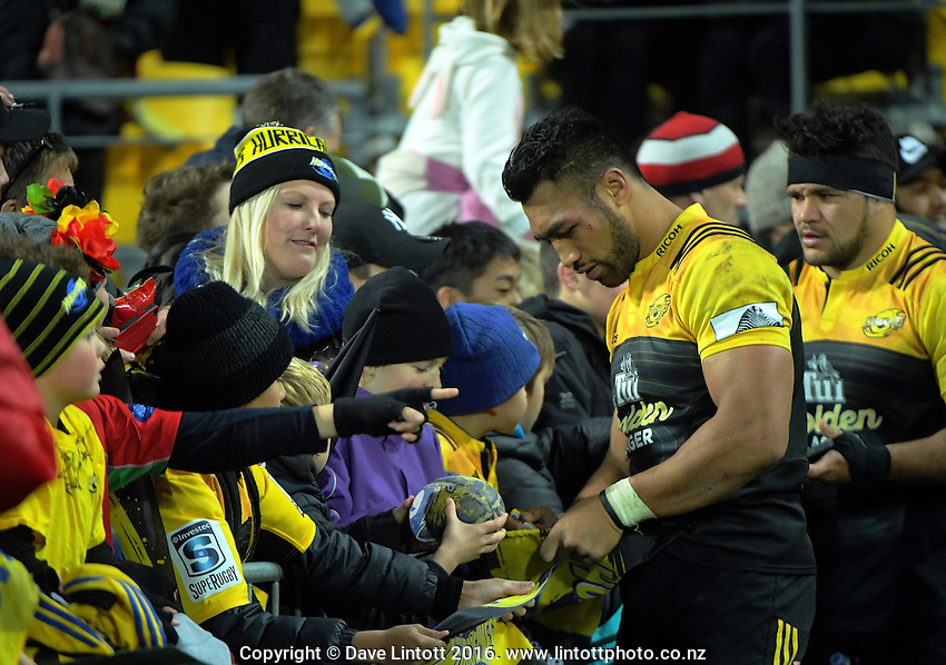 Victor Vito signs autographs after the Super Rugby semifinal match between the Hurricanes and Chiefs at Westpac Stadium, Wellington, New Zealand on Saturday, 30 July 2016. Photo: Dave Lintott / lintottphoto.co.nz