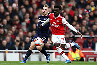 7th March 2020; Emirates Stadium, London, England; English Premier League Football, Arsenal versus West Ham United; Bukayo Saka of Arsenal competes for the ball with Jarrod Bowen of West Ham United