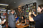 "Husband Anthony Michael Jones takes a photo of Another World's Alicia Coppola as signs her book ""Gracefully Gone"" - a fusion of two journals: her father Matthew L. Coppola Sr. and hers - on August 23, 2013 at Book Revue, Huntington, New York. (Photo by Sue Coflin/Max Photos)"
